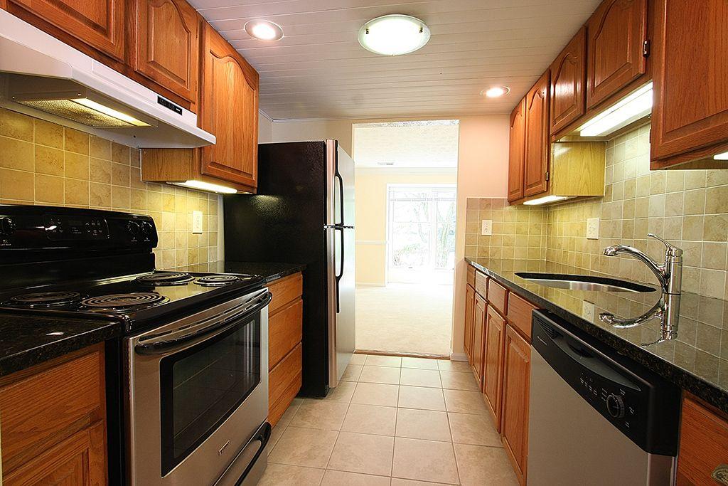 Oak street kitchen with black appliances