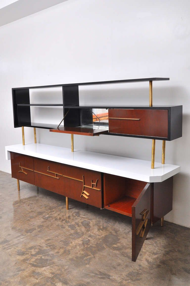 Eugenio Escudero; Mahogany, Brass, Bronze and Glass Credenza with Floating Hutch and Bar, 1950s.