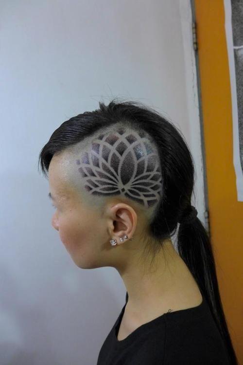 Designs shaved into head