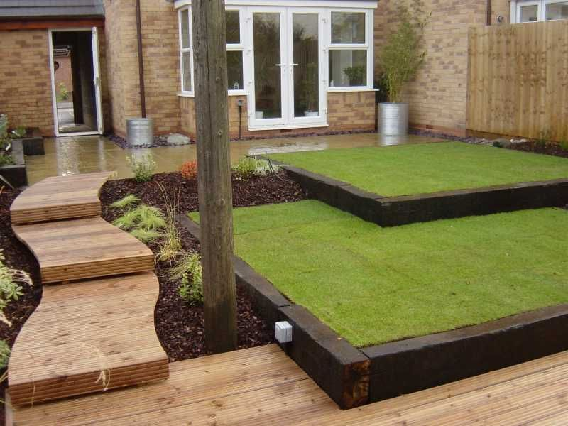 immaculate two level lawn with railway sleeper pathway wavy line and straight edge contrast soft and hard textures nicely combined