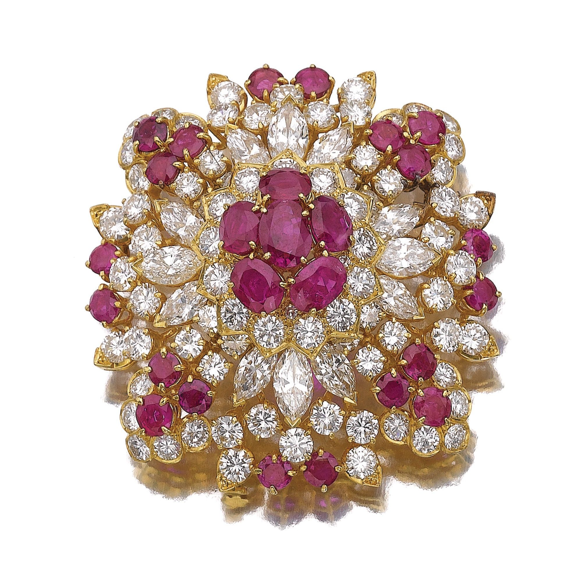 RUBY AND DIAMOND BROOCH, VOURAKIS Of bombé form, set with marquise-shaped and brilliant-cut diamonds, oval and circular-cut rubies