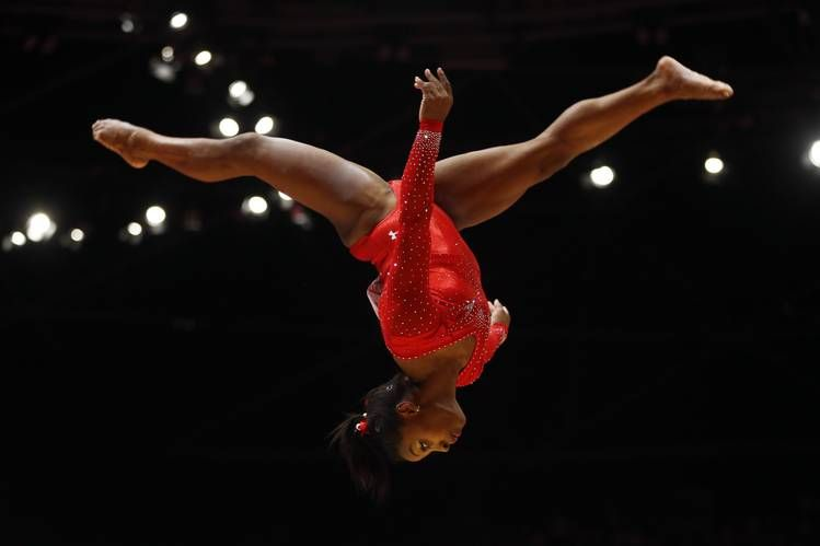 World champion gymnast Simone Biles has won three consecutive individual all-around titles, plus gold medals...
