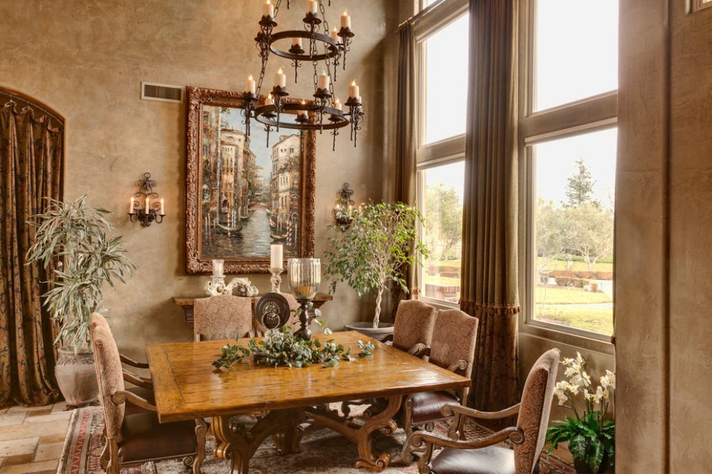 Elegant Tuscan Dining Room With Wrought Iron Chandelier Over Square Table And Decorated With Housepla Tuscan Dining Rooms Mediterranean Decor Tuscan Decorating