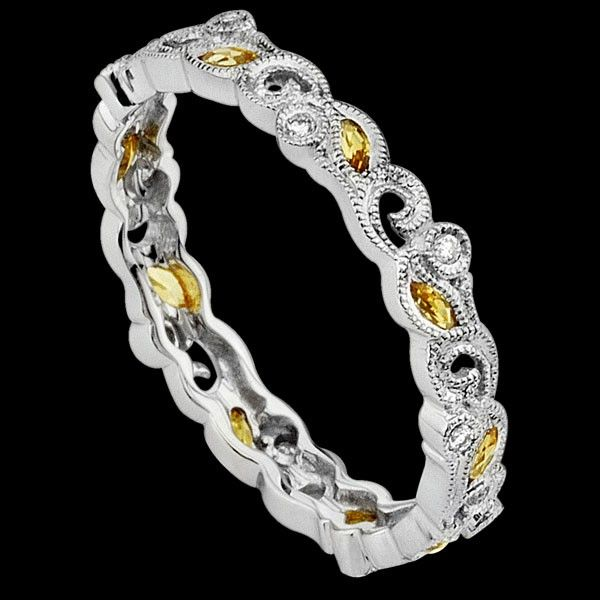 Floral wedding band. This would be stunning with different coloured stones or all in diamonds.