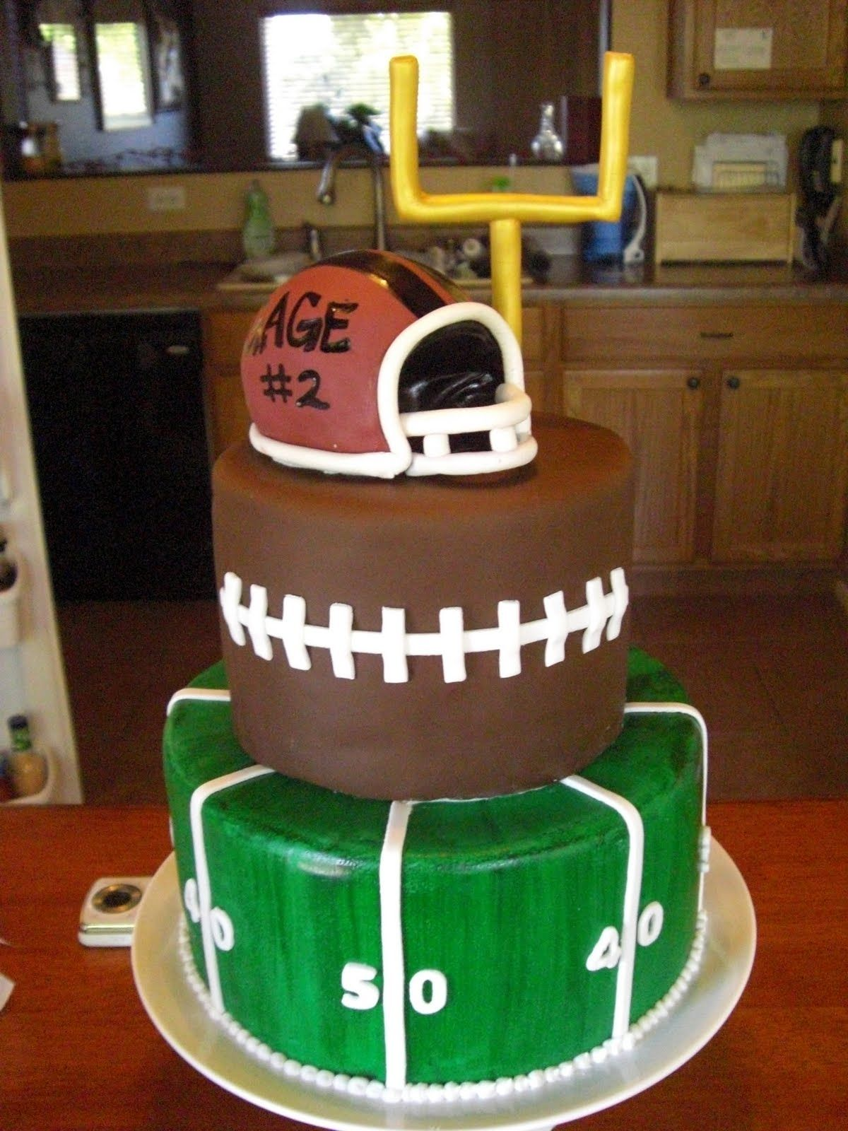 How To Make A Football Cake The Cake Shoppe Football Birthday