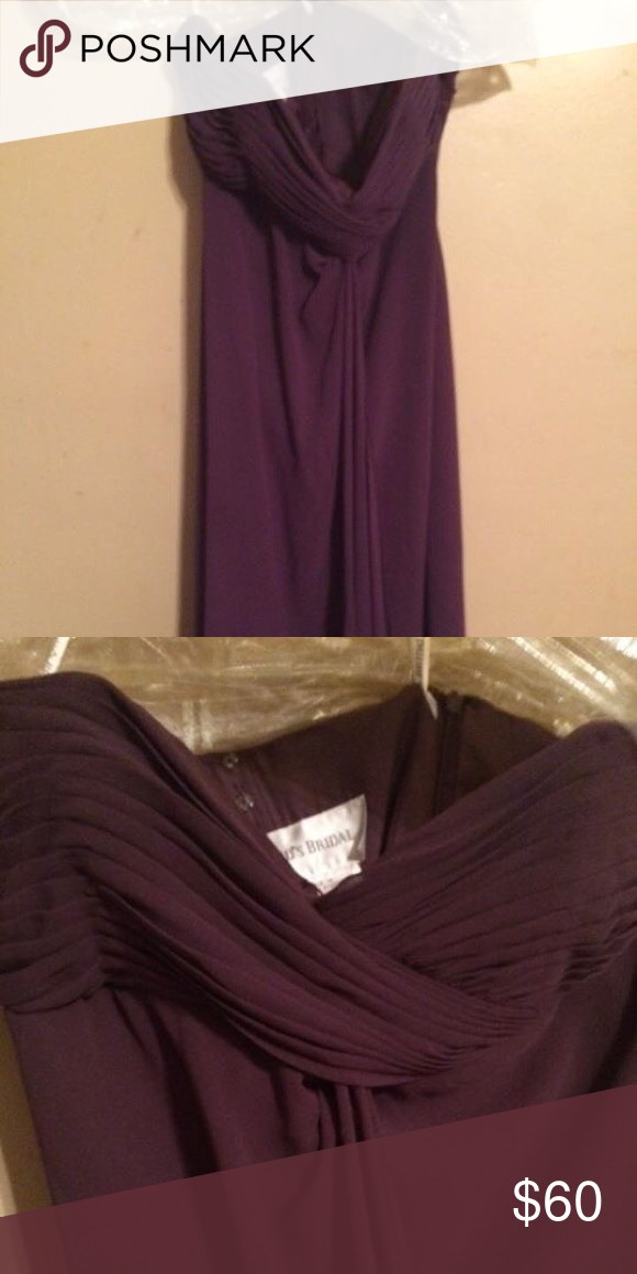 Davids Bridal Plum Formal Dress Comes to mid-calf, worn once, NS home, perfect condition. Plum colored. Spaghetti straps are removable. David's Bridal Dresses