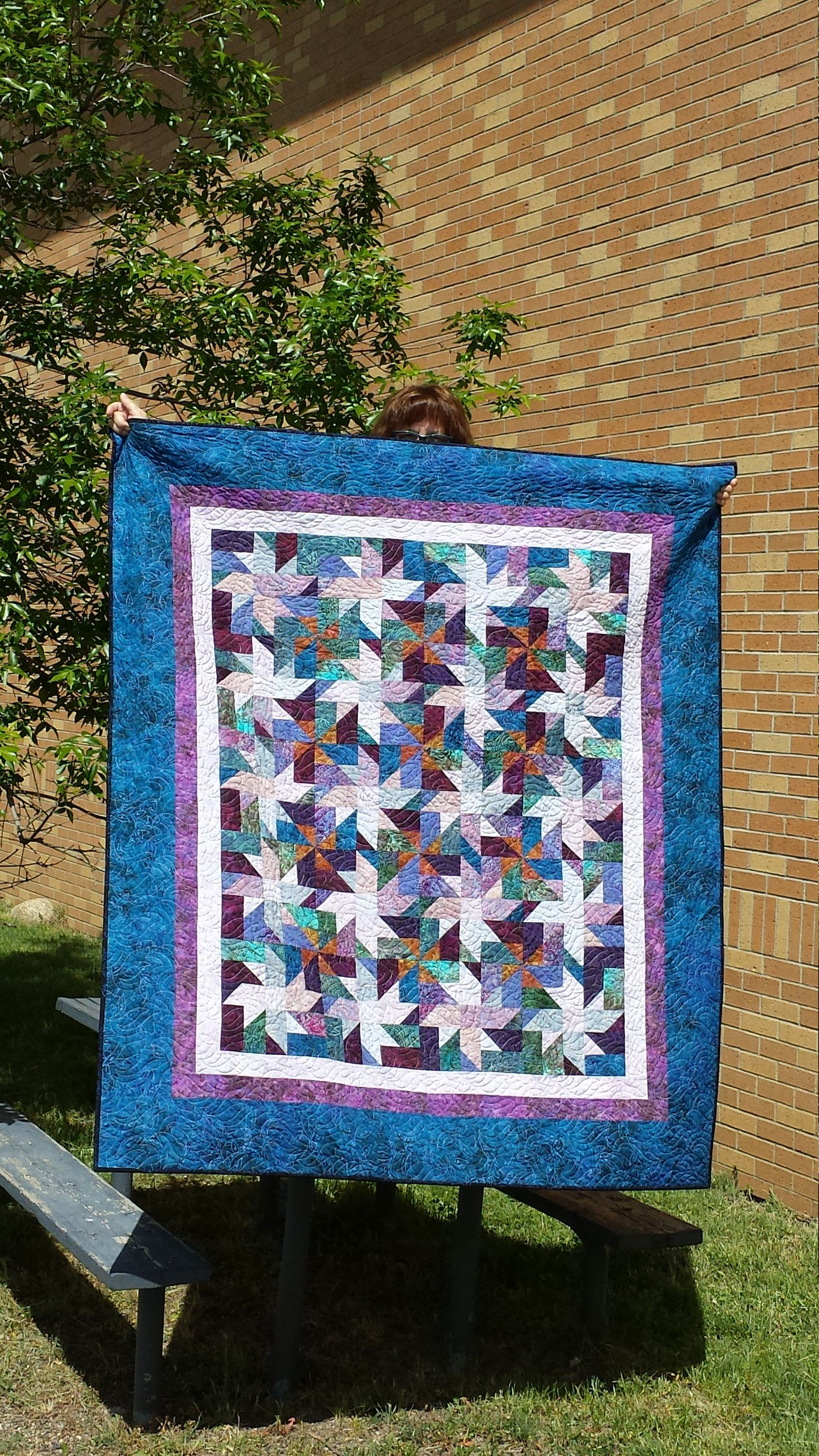batik quilt kit in a mix of rich blue and purple pre cut fabric