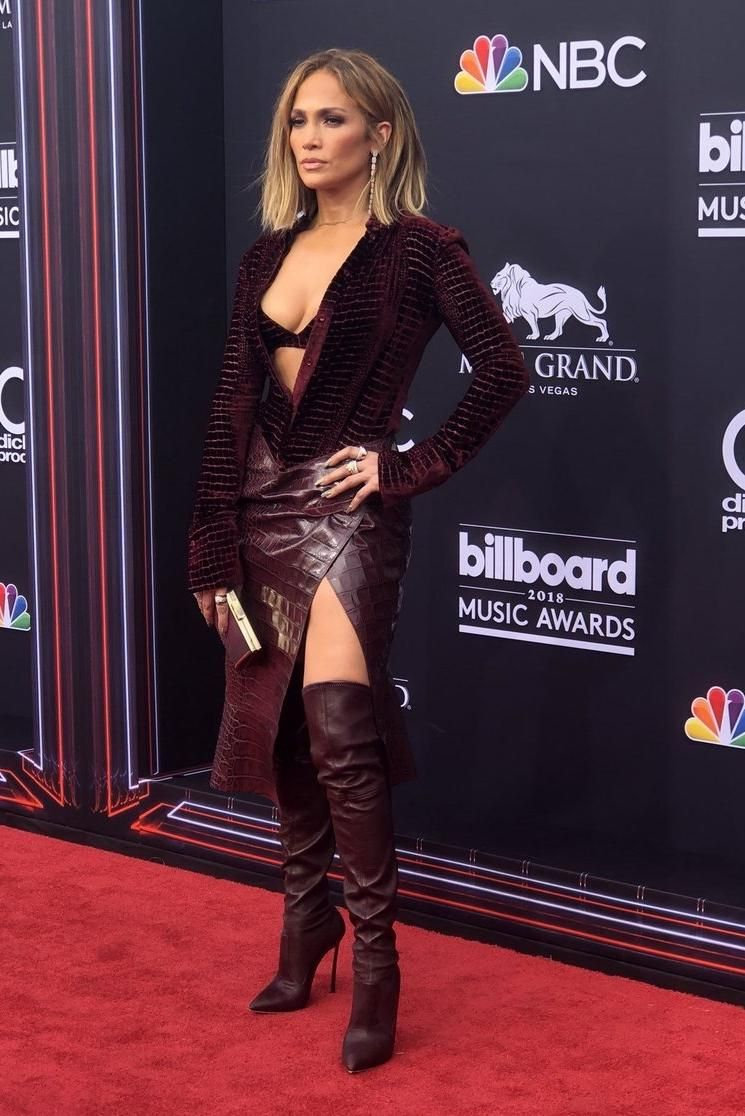 c3ac8502ed2248 Jennifer Lopez wears a Roberto Cavalli top, Skirt , and Boots to the  Billboard Music Awards