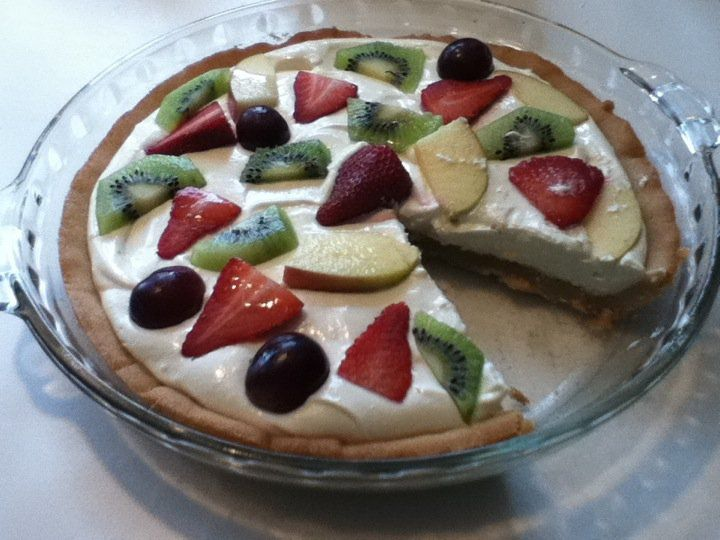 Fruit pie.  Sugar cookie crust with a cream cheese and sugar filling, topped with fresh fruit.