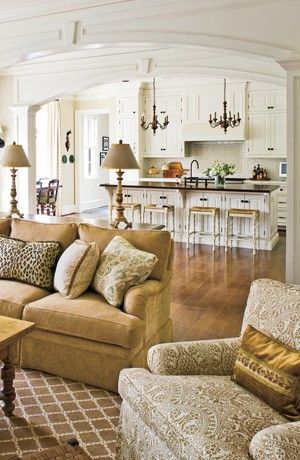 kitchen open to family room, arch, moulding, white, chandeliers over island, chair fabric