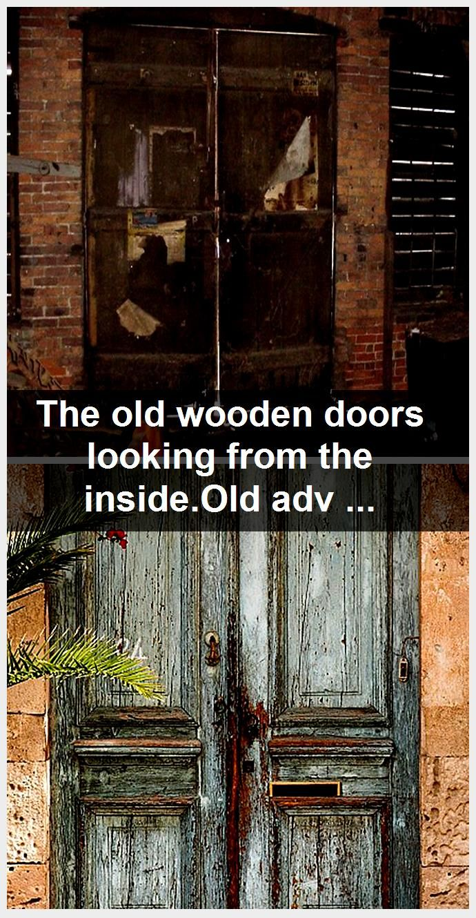 Photo of The old wooden doors looking from the inside.Old advertisements hanging on door.,  #advertise…