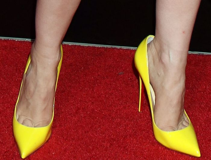 f91939c42aa3 Jessica Chastain wearing yellow Christian Louboutin pumps at CinemaCon 2017