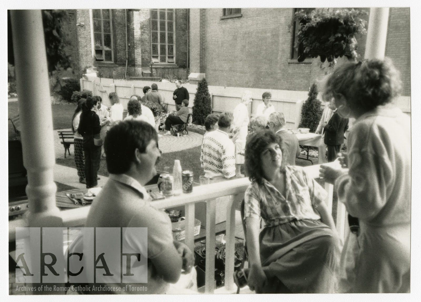 Chancery office employees enjoy a lovely picnic in St Michael's Cathedral garden in 1989.