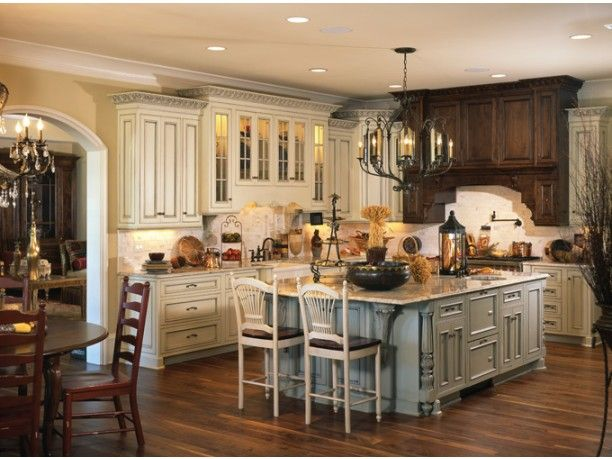 Here's proof that mixing and matching different colors and finishes in the kitchen can look gorgeous. Also, we love how plan HWEPL65679 has the island here modified a bit from the plan.