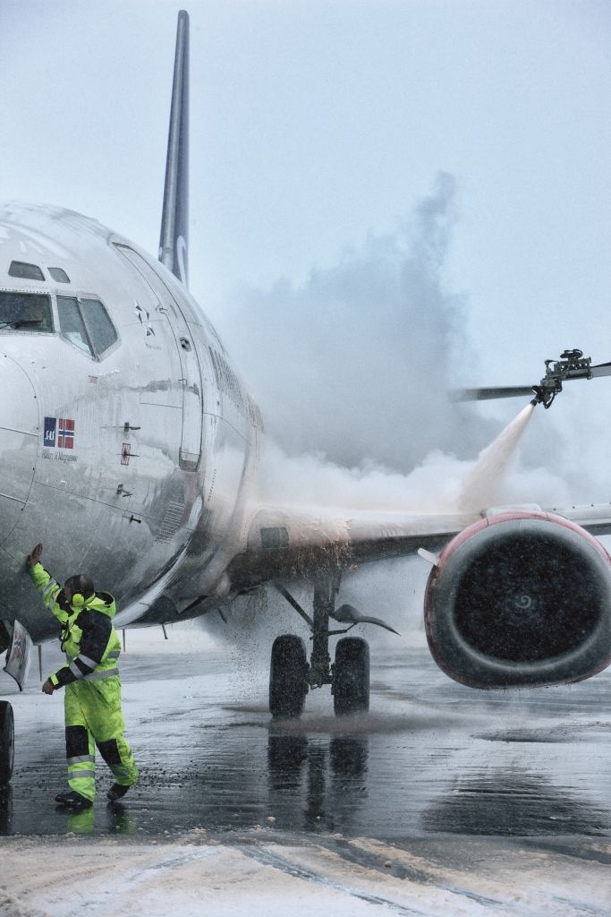 Nordic feeling. Deicing of a SAS plane on a cold winters day in Copenhagen Airport, Denmark.