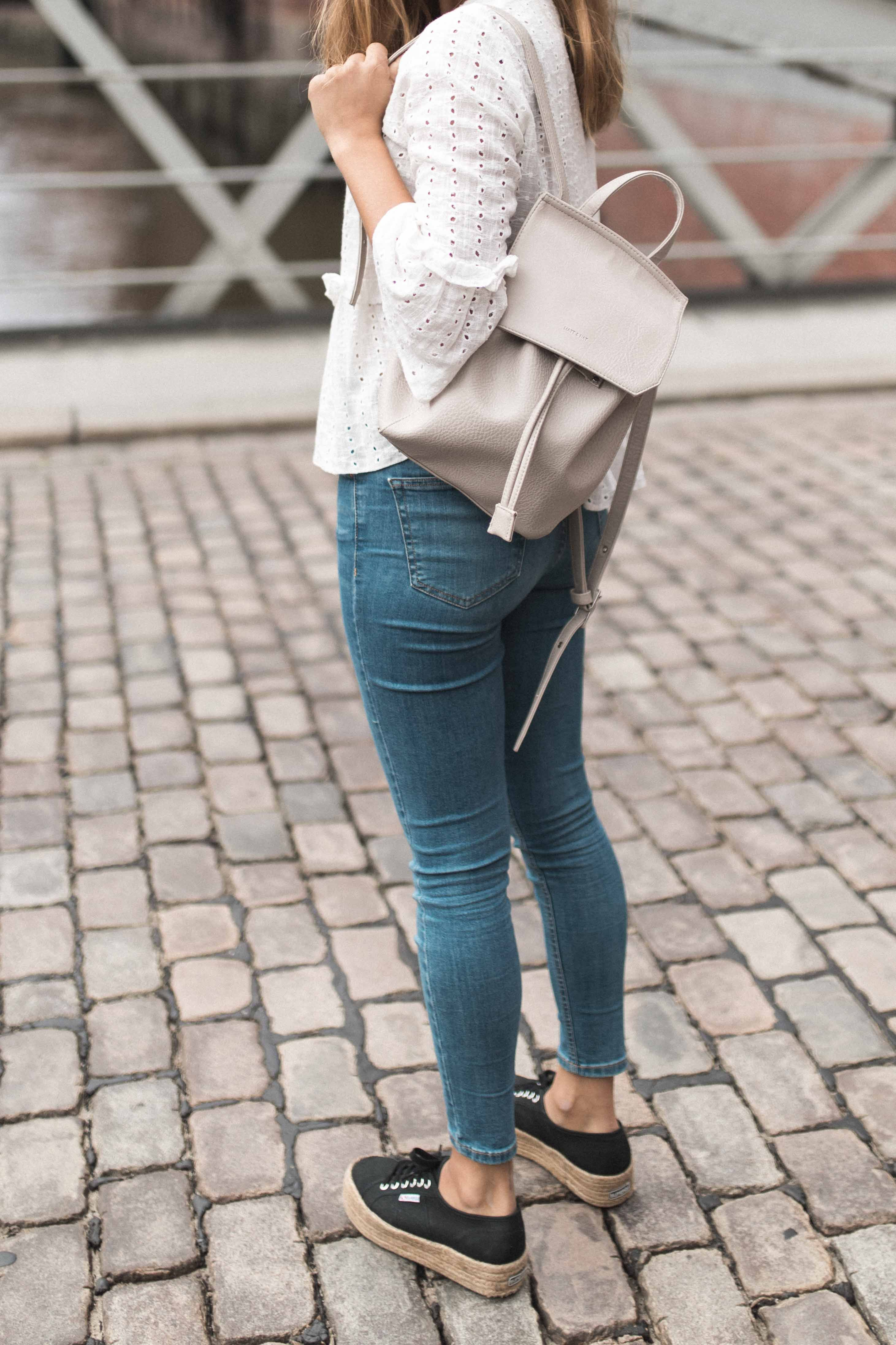 online store 0bd7b ee245 white blouse with cut-outs, vegan matt   nat backpack, black superga  plateau shoes and jeans by blogger annalaurakummer