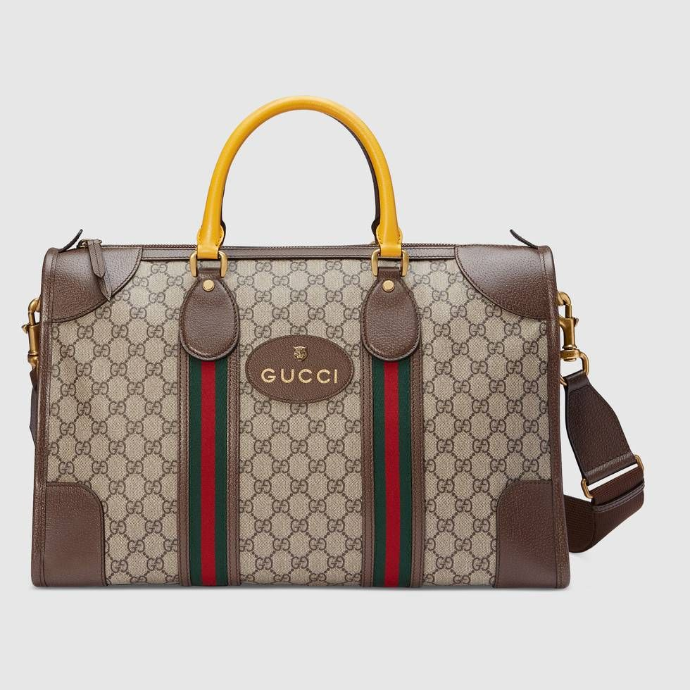 79564c2b14cd Shop the Soft GG Supreme duffle bag with Web by Gucci. A collection of  vintage inspired duffle bags speaks to the contemporary voyager, trimmed  with the ...