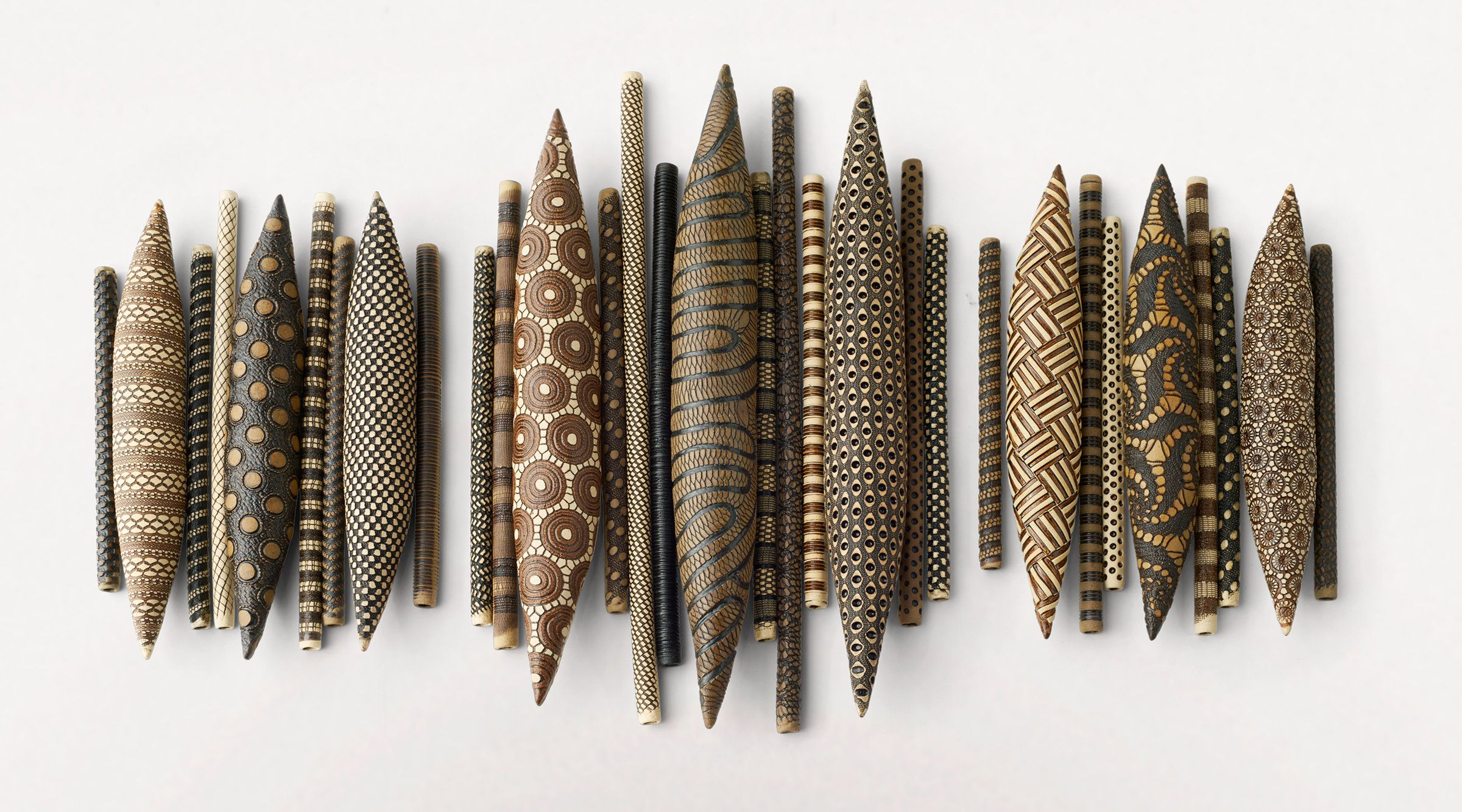 Domestic Markings: Balance by Kelly Jean Ohl. Intricate textures and earthy colors combine in this striking sculptural installation. A variety of individual