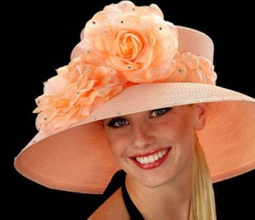Elegant Mature Woman In Hat And Coat Posing In Studio Stock Photo