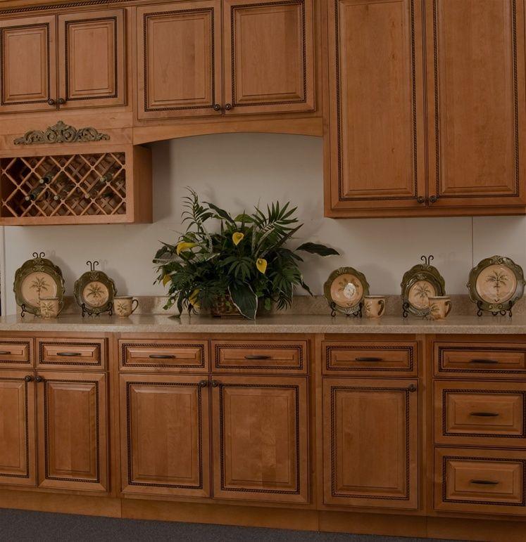 Light Cherry Rope Cabinets I think i like the ornate ...