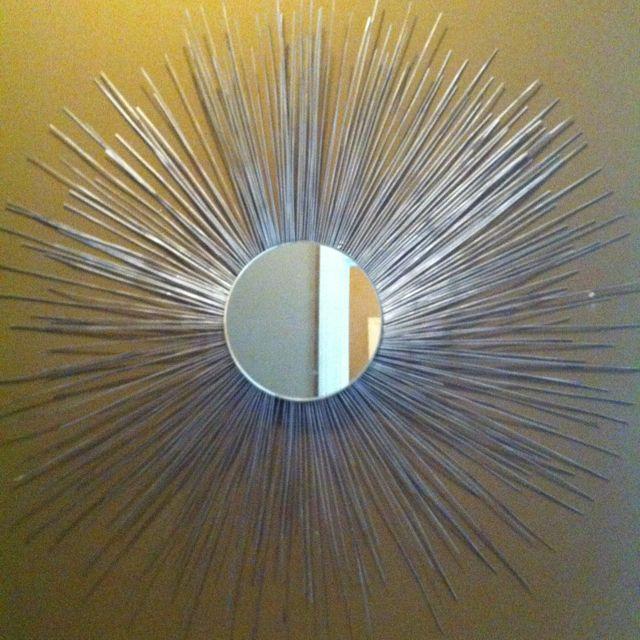 DIY sunburst mirror....dollar tree mirror, hot glue and skewers + spray paint or glitter