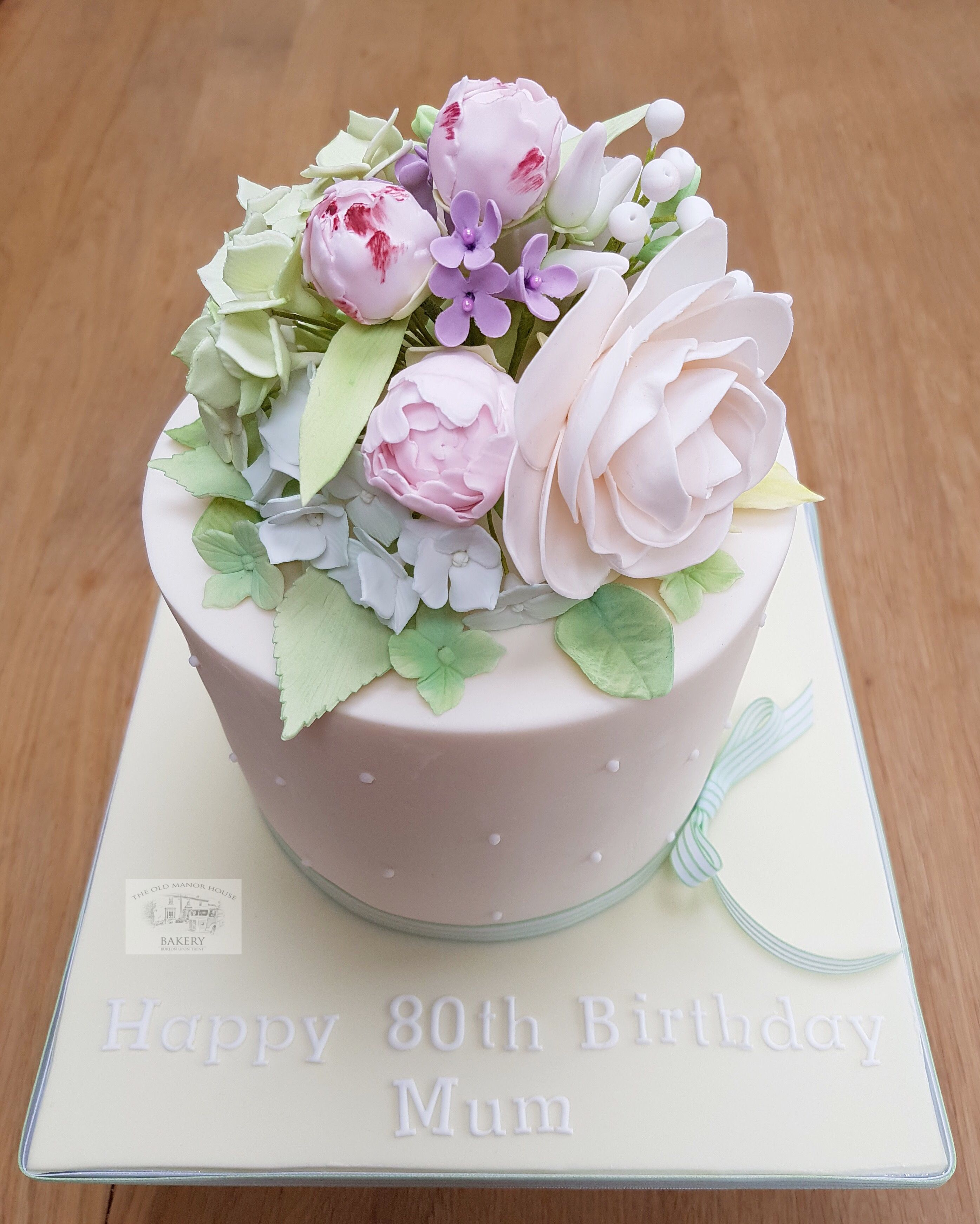 Ladies 80th birthday cake with posy of sugar flowers