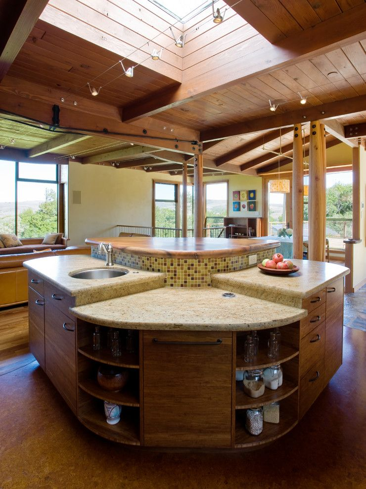 rustic kitchen island in curve shape and with storage of Tens of Inspiring Kitchen Islands with Storage and Chairs