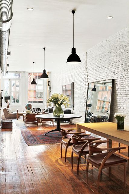 the black pendant lamps kick up the lofts industrial cool vibes refinery29 httpwwwrefinery29com20150384367jonah hill sells nyc apartmentslide 4