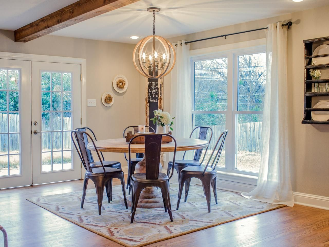 Fixer upper kitchen chandeliers - As Seen On Fixer Upper French Doors Floor To Ceiling Windows And A Stylized Chandelier Bring Loads Of Light Into The Breakfast Room
