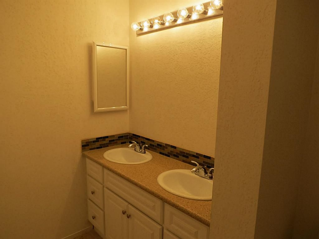 The upstairs full bath has been extensively remodeled.  The mirror will be installed soon.
