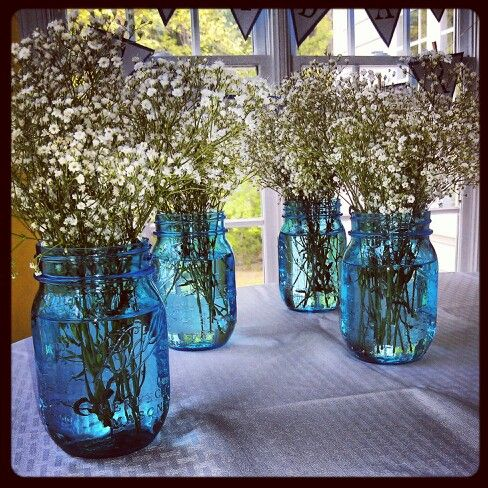 blue mason jars and babys breath as center pieces at my best friends something blue themed bridal shower