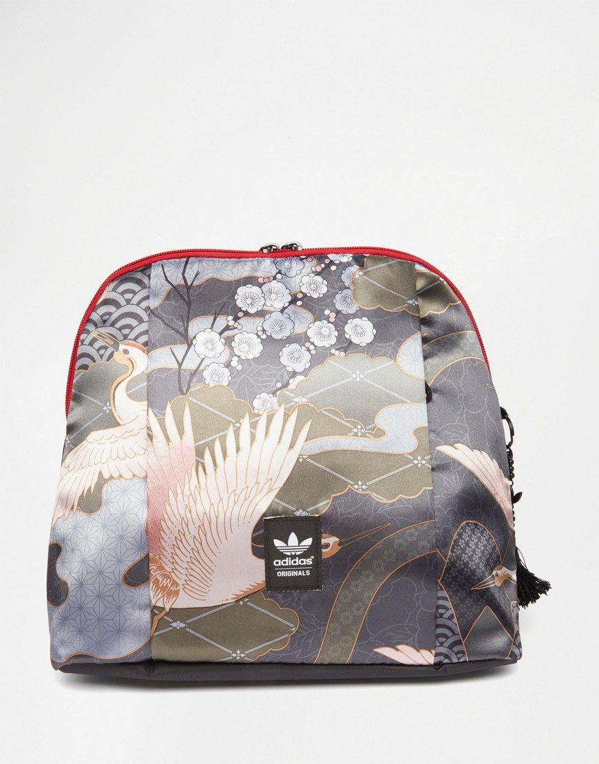 5936244549 Image 1 of adidas Originals Rita Ora Bird Print Backpack White Backpack