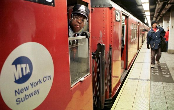 A Conductor On The Number 5 Train Checks To Make Sure The Doors Are Conductors Number 5 Photo