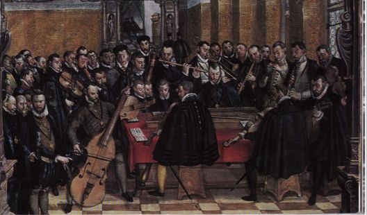 c. 1575—Munich, Germany: A contemporary painting of the Munich court by Hans Mielich depicts Orlando Lassus, seated at the keyboard, with his ensemble of musicians around him, including trombone, cornett, woodwinds, and strings