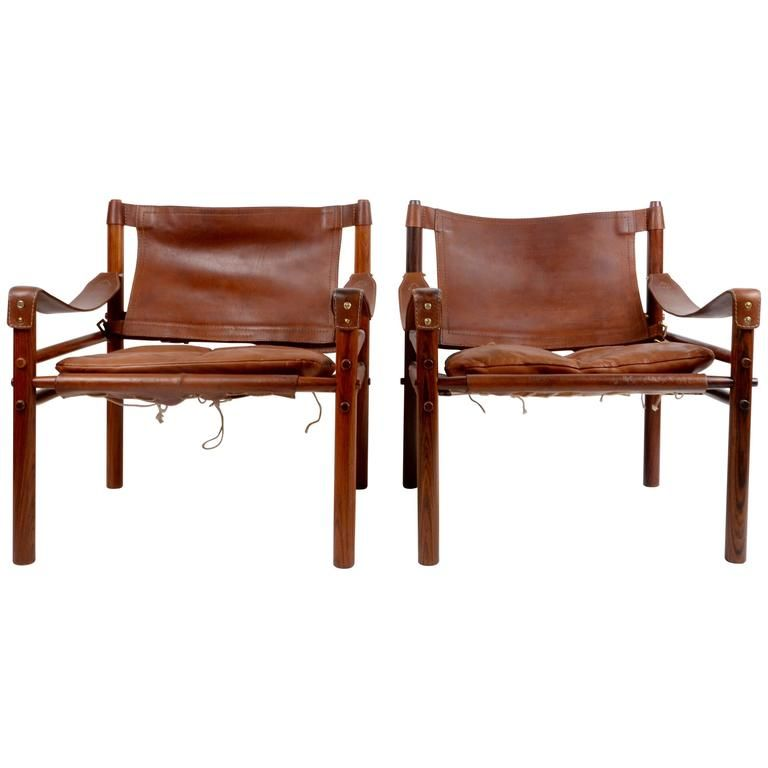 """Pair of """"Sirocco"""" Safari Chairs Designed by Arne Norell, Sweden, 1960s   From a unique collection of antique and modern lounge chairs at https://www.1stdibs.com/furniture/seating/lounge-chairs/"""