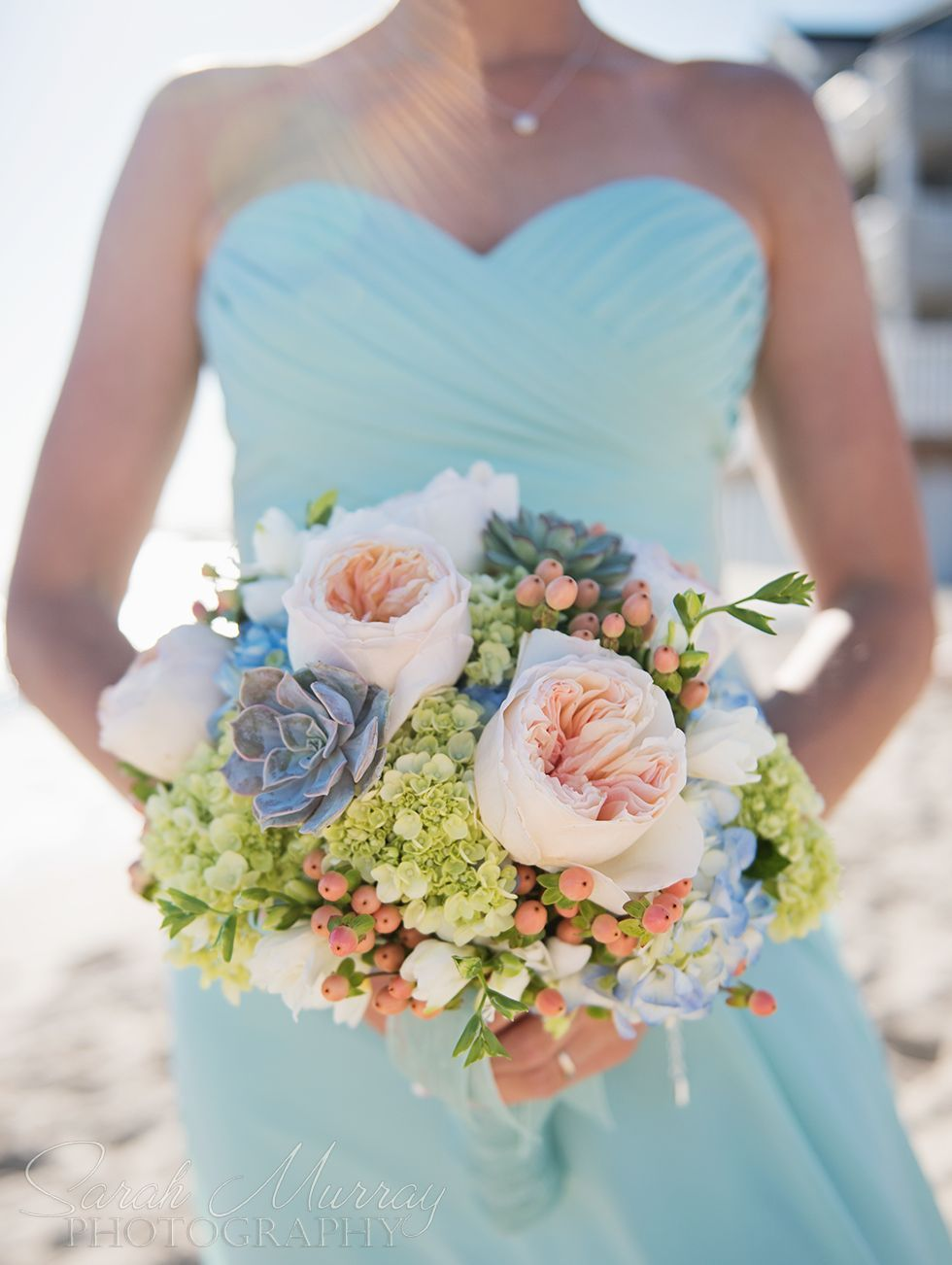 Peach roses blue and green hydrangeaus succulents and more accent