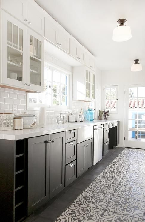 White And Black Kitchen Features Glass Upper Cabinets And