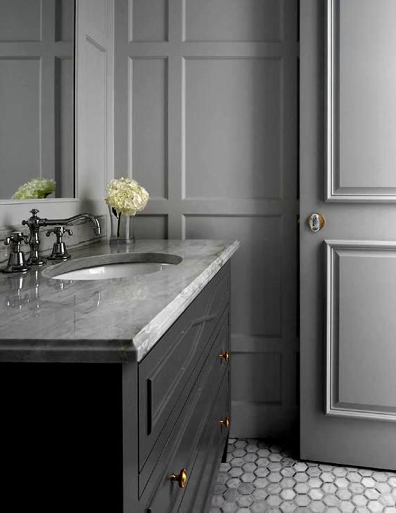 Chic Monochromatic Gray Bathroom Boasts A Dark Gray Washstan In
