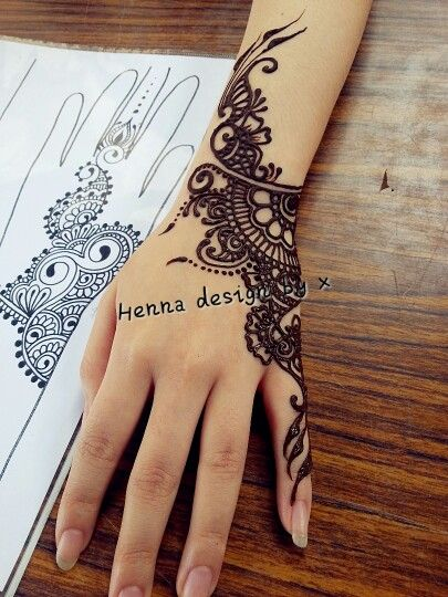 love love henna that focuses on one side of the hand