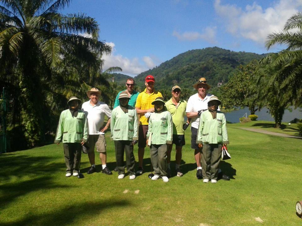 Mr Glenn & Friends at Loch Palm GC with caddies. Caddies