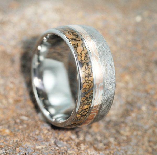 Unique Statement Ring - Titanium Band with Meteorite, Dinosaur Bone and Mokume Gane  Pinstripes. $799.00, via Etsy.