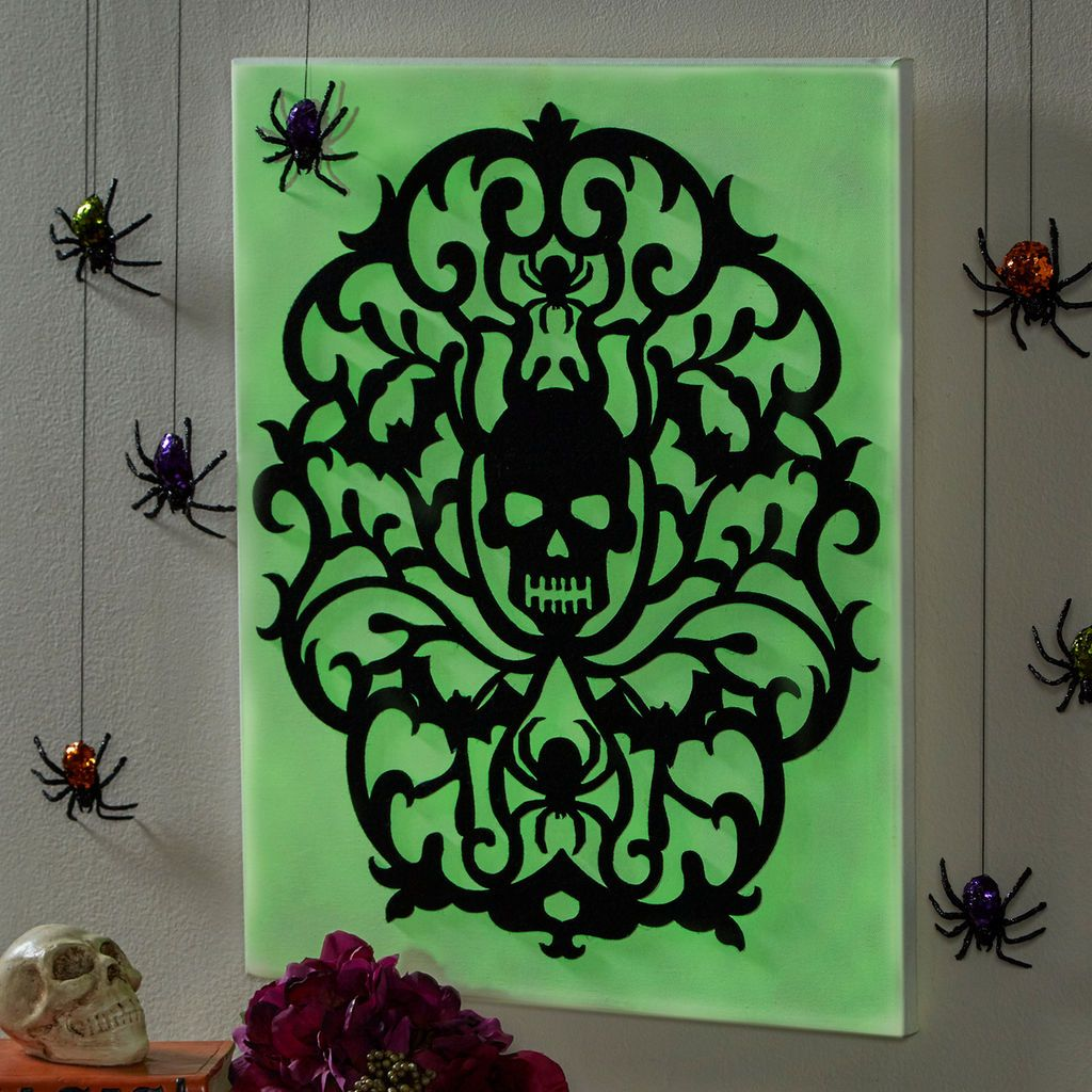 This glow-in-the-dark skull canvas is so easy to make Simply paint - glow in the dark halloween decorations