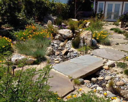 Pebble and rock river bed for garden drainage  Dig trench