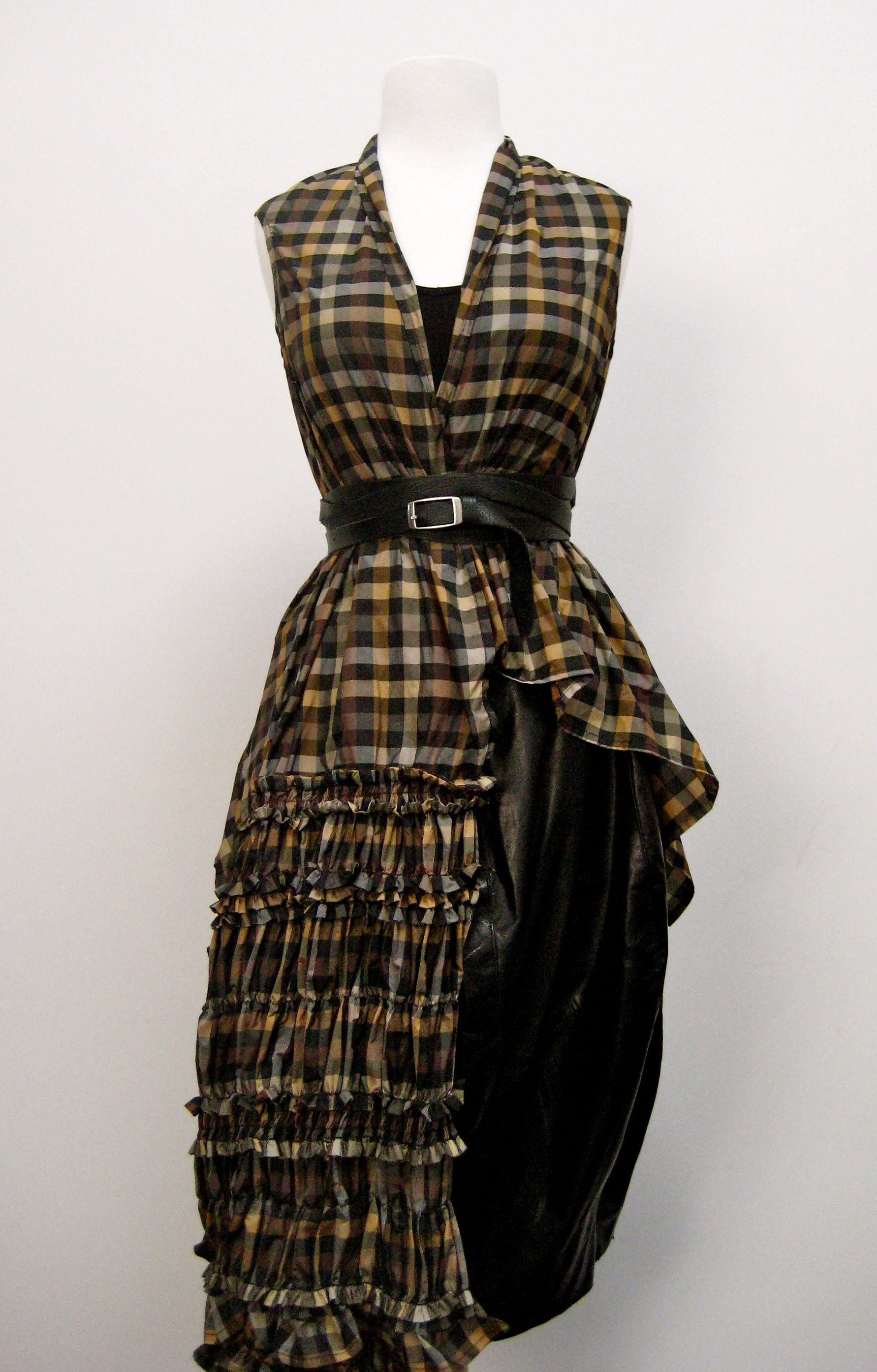 Beryll skinny wrap belt over an amber Ivan Grundahl plaid vest wrap paired with an Ivan Grundahl leather tulip skirt with side ruffle detail.