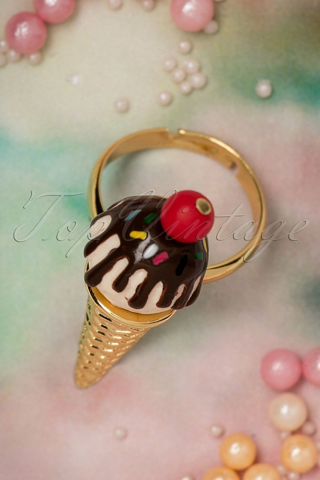 You can't buy happiness, but you can buy this 50s The Candy Store Ice Cream Ring!Ohh well, that's kind of the same thing ;-) This stunning, adjustable ring is made from brass and the scoopes of ice cream are hand enamelled with layers of resin. Summer sweetness at it's best!    Adjustable Hand crafted Comes with a cute fabric bag