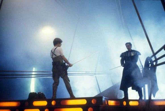 Mark Hamill and Bob Anderson practicing the lightsaber duel on the Bespin freeze chamber set.