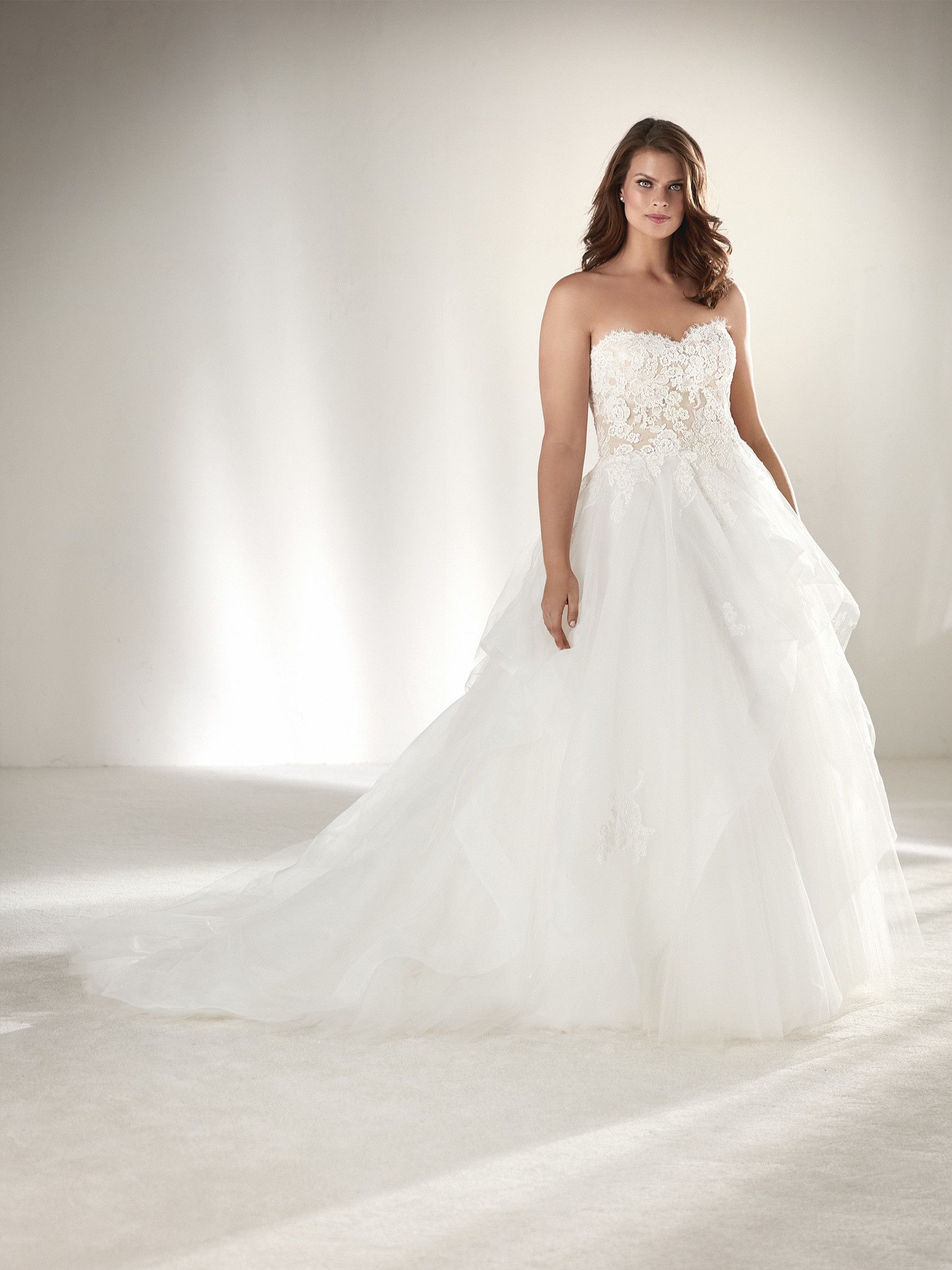 f5054c33f913f Pronovias Draval, a strapless, frilled tulle with lace, princess, plus size  wedding dress at Brides of Chester.