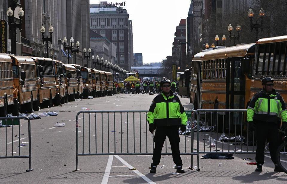 Blasts Rock Marathon School buses lined both sides of