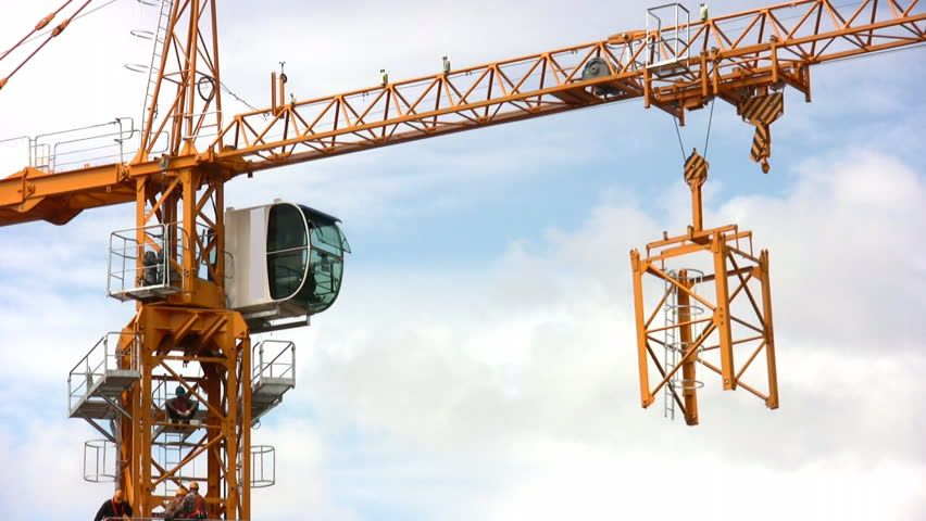 Construction Crane | Lot of building materials at construction site of high-rise dwelling ...