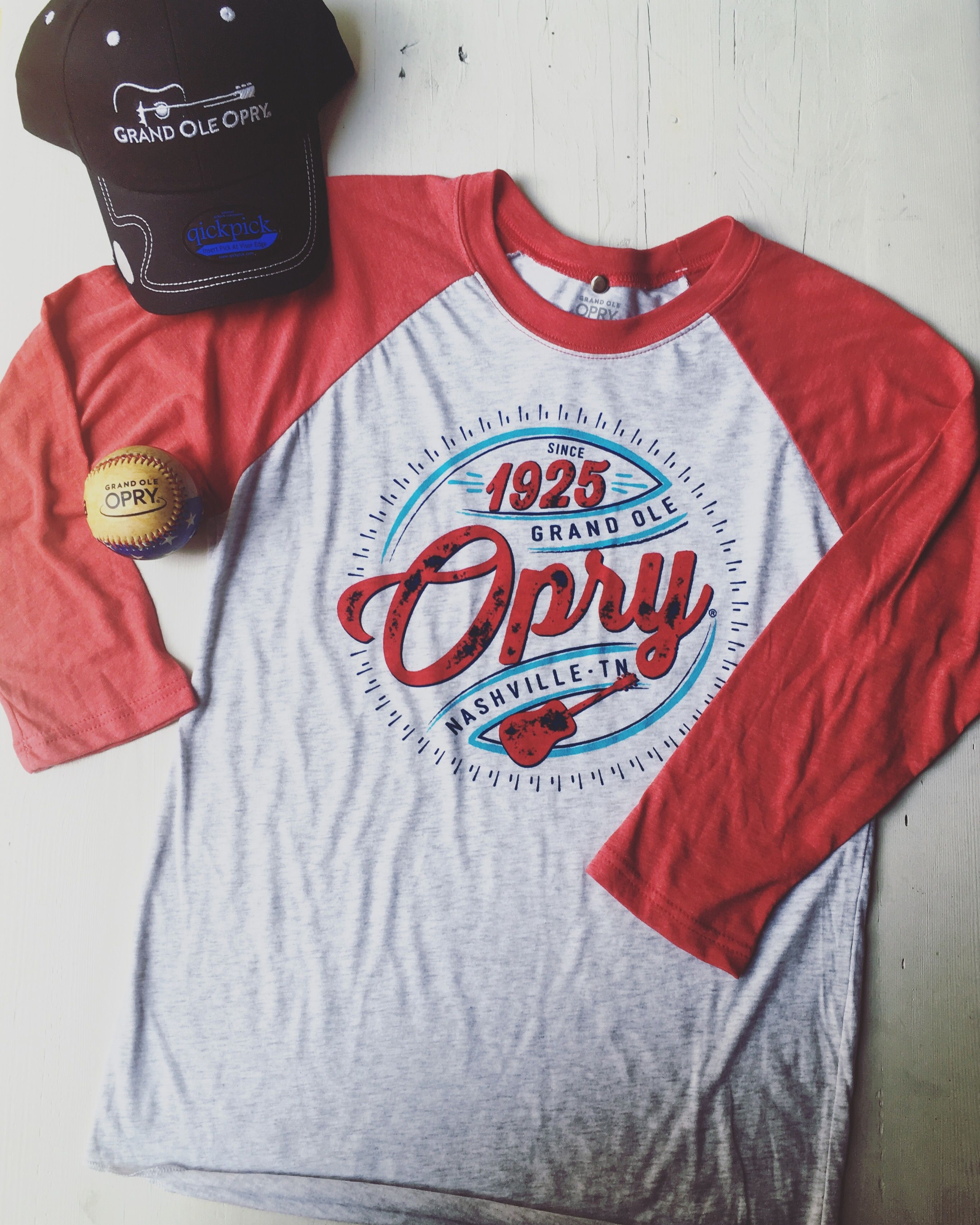 Root for the home team with this baseball tee and hat.
